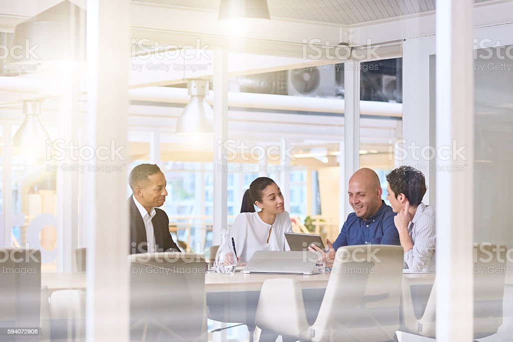early morning sunrise business meeting in modern office conference room stock photo