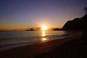 Early Morning Sunrise on Waimanalo Beach over Rock Island bursti