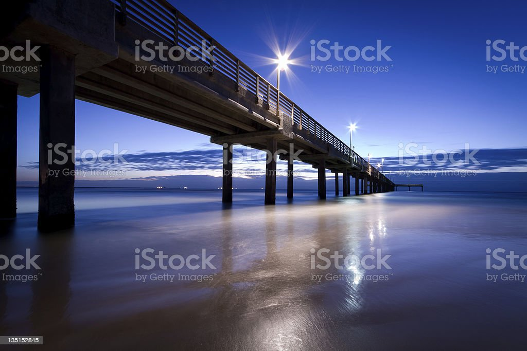 Early Morning Sunrise with Concrete Pier stock photo
