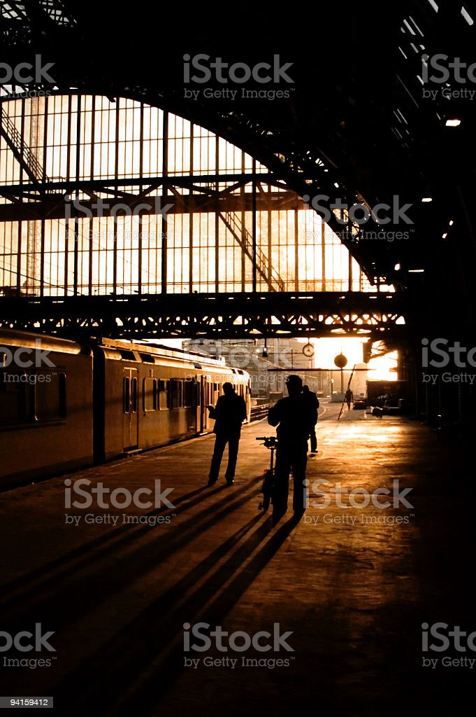 Early morning trainstation scene at Amsterdam Central Station royalty-free stock photo