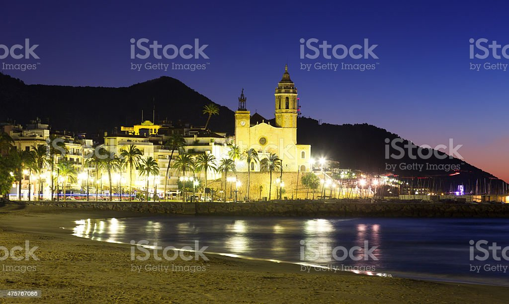 Early morning view of  church at  beach. Sitges stock photo