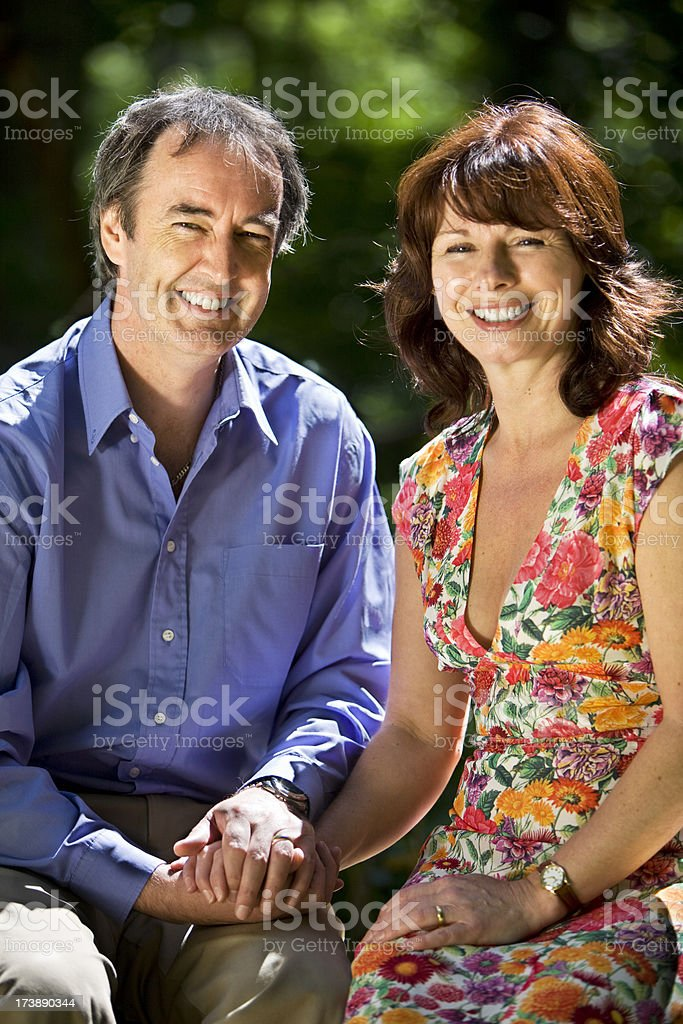 early retirement: bright smiling mature couple royalty-free stock photo