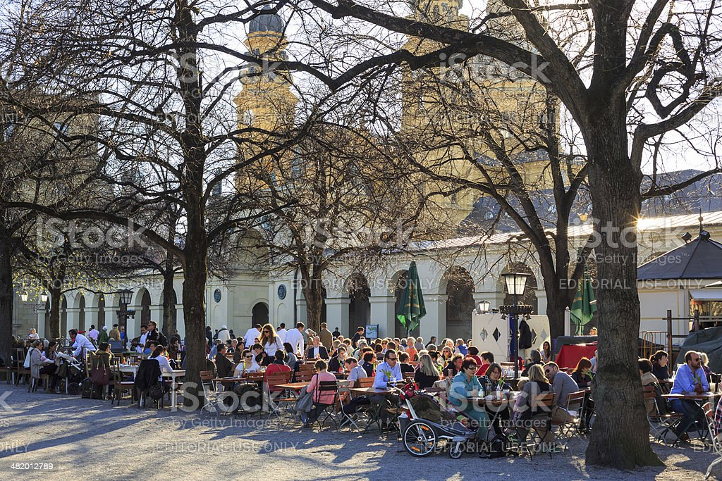 Early spring in an outdoor cafe in Munich stock photo