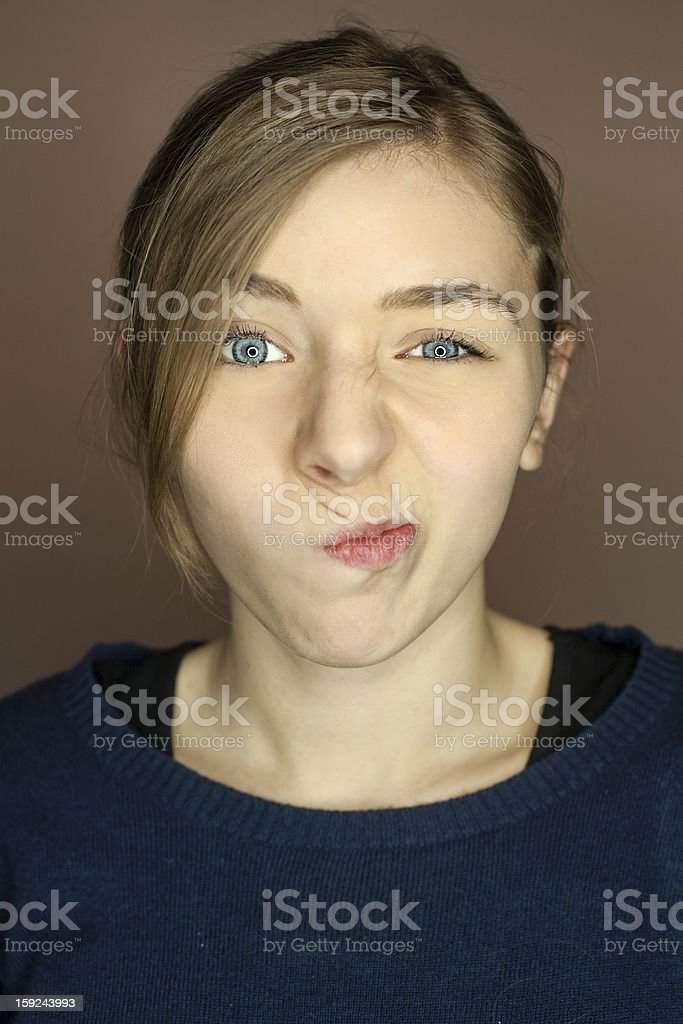 early teen making a face stock photo