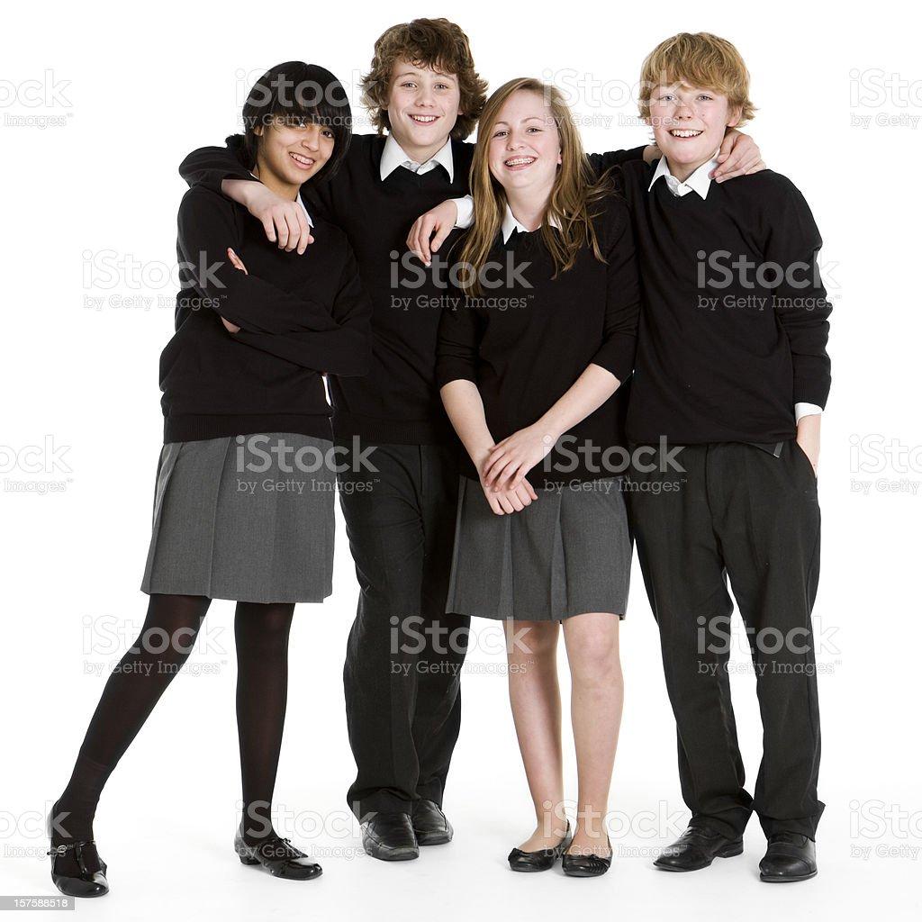 early teen students: full length portrait of uniformed school friends royalty-free stock photo