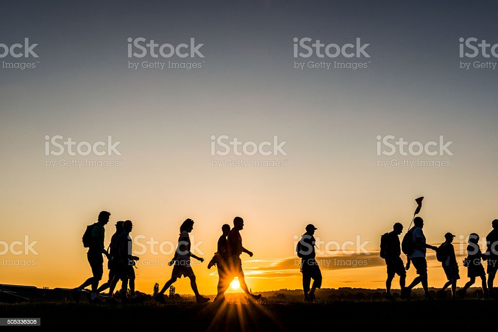 Early walkers at sunrise stock photo