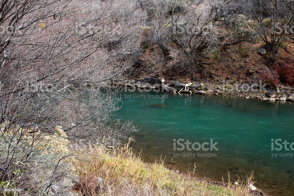 Early winter view of a turqouise river stock photo