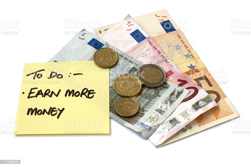 Earn More Money Post It Note with Change and Notes royalty-free stock photo