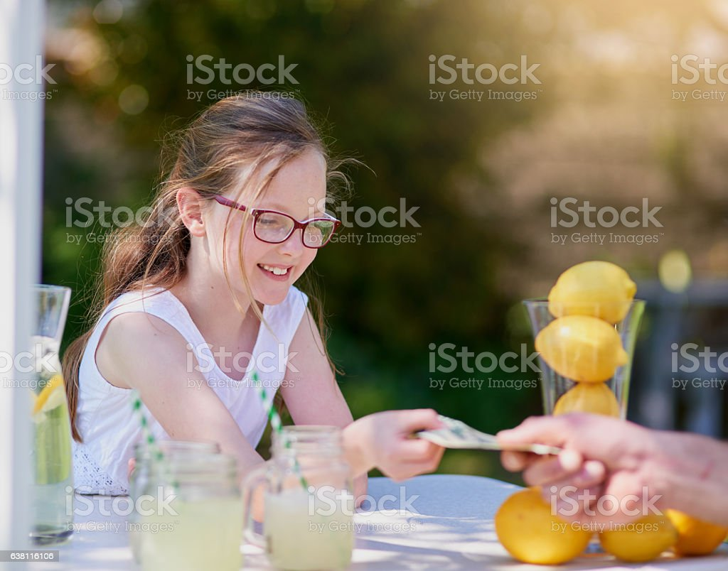 Earning her own pocket money by becoming a young entrepreneur stock photo