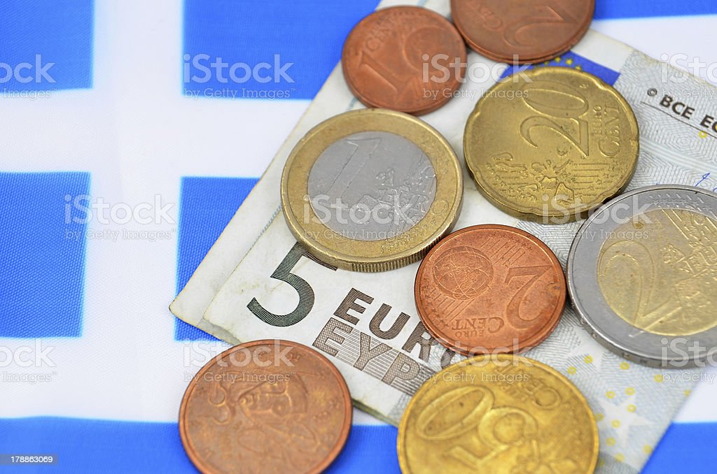 Earning in Greece concept with money and flag royalty-free stock photo