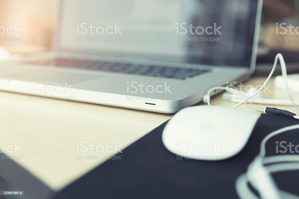 earphone and laptop computer notebook on wooden table, vintage t stock photo