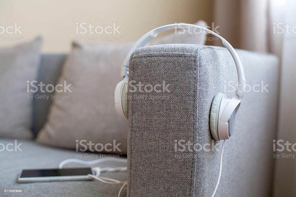earphone and smart phone on sofa stock photo
