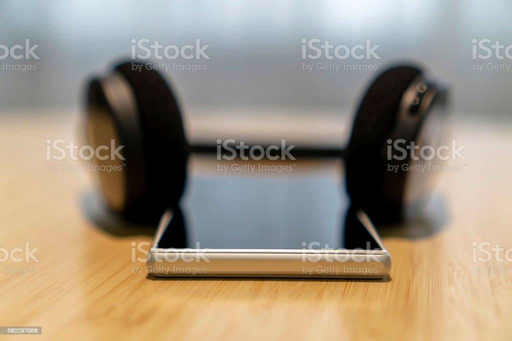 earphone and smart phone on table stock photo