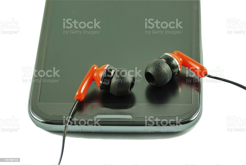 Earphone  and smartphone royalty-free stock photo