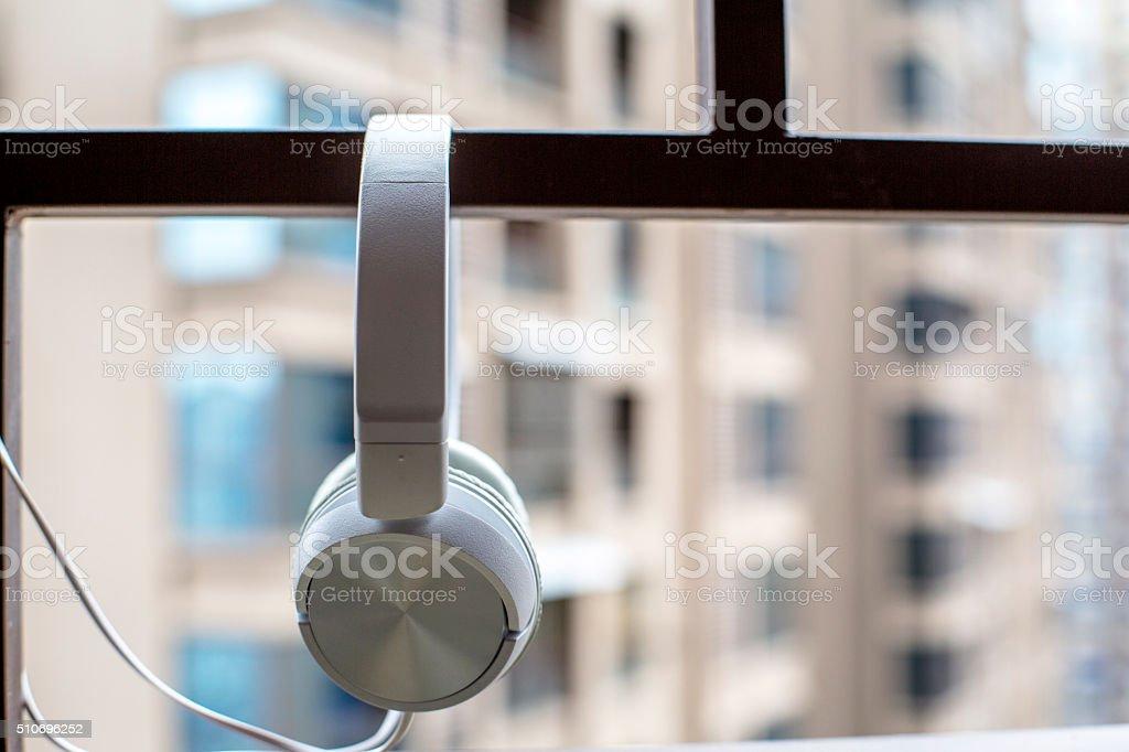earphone hanging on iron railing of balcony stock photo