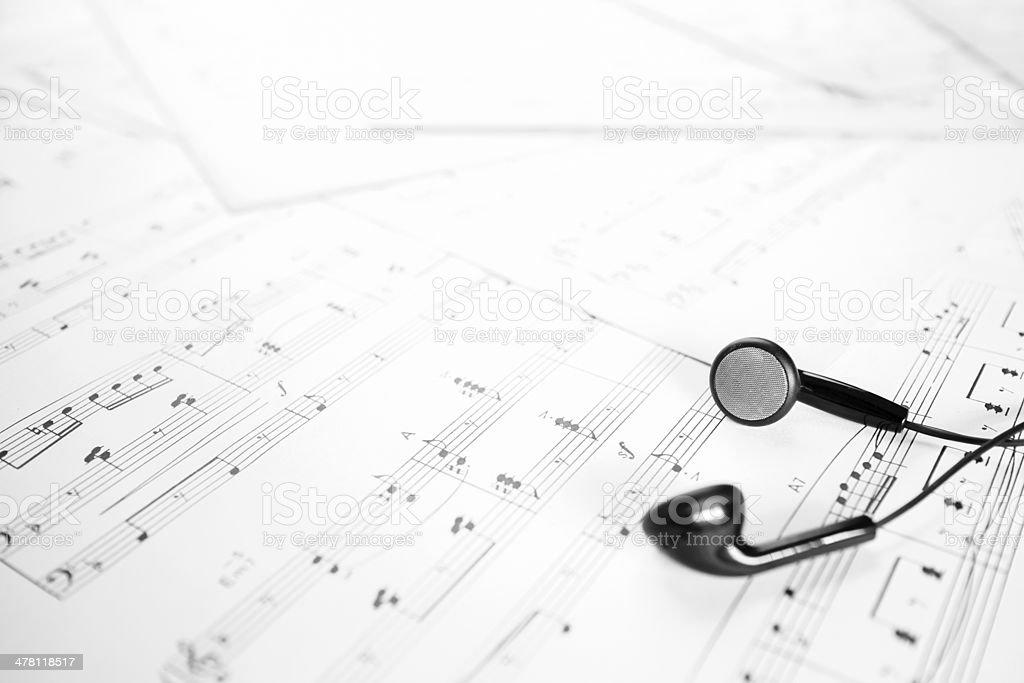 earphone on music sheet stock photo