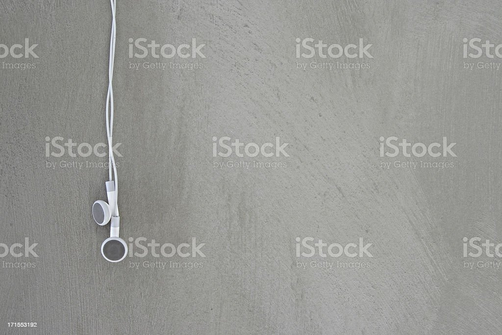 Earphones and concrete royalty-free stock photo