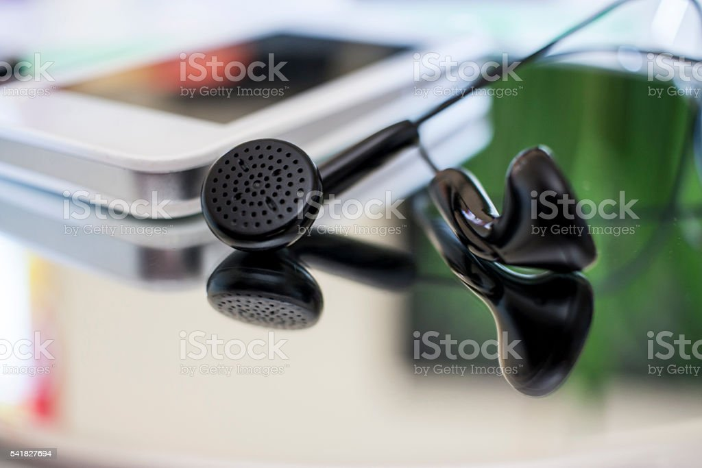Earphones and smartphone stock photo