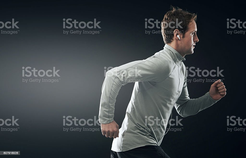 Earphones with a strong performance just like his workout stock photo