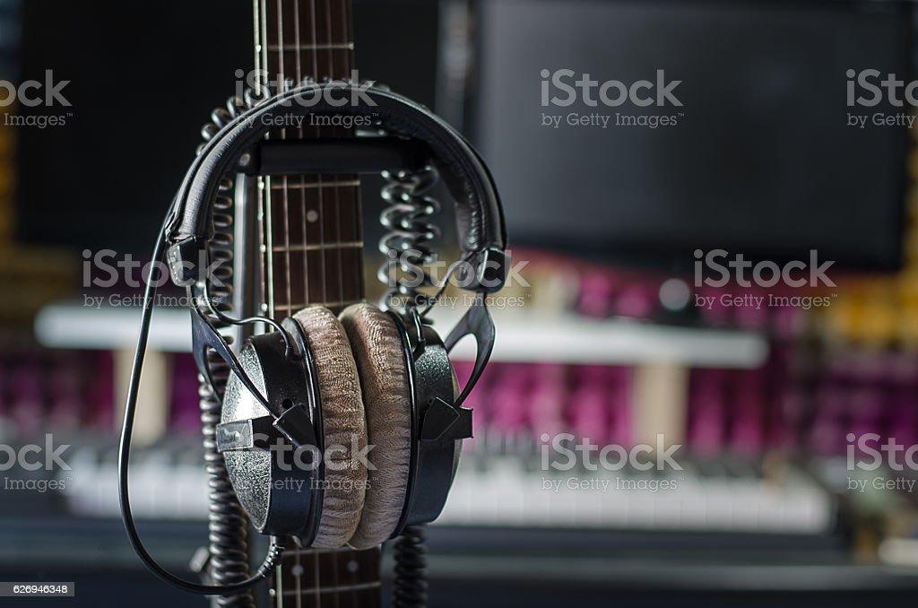 Earphones with neck guitar in the studio. stock photo