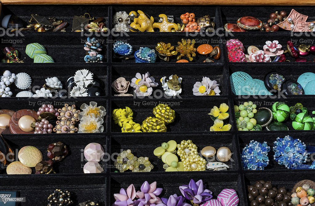 Earring clip-ons at flea market royalty-free stock photo