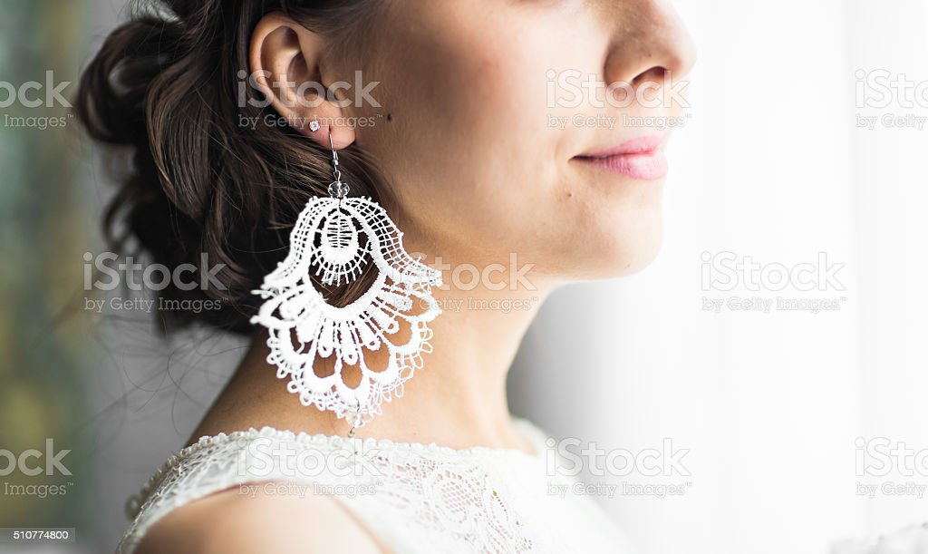 earring in the ear stock photo