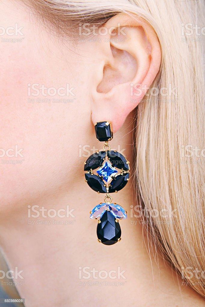 earring on woman's ear stock photo