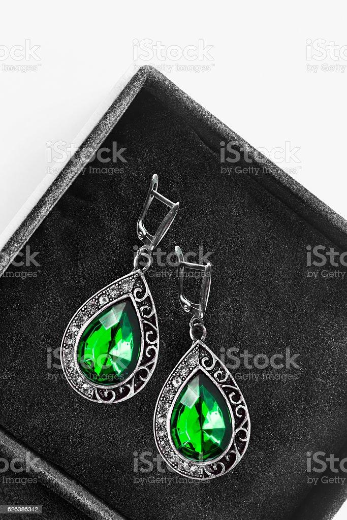 Earrings in a box stock photo