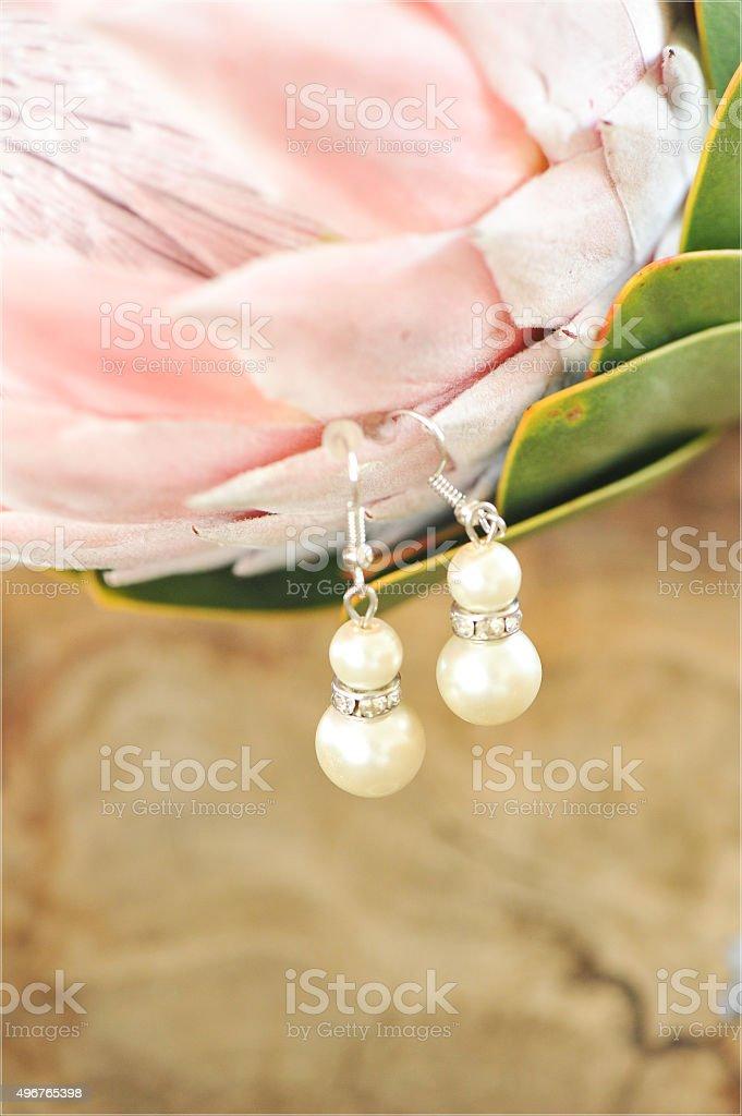 Earrings on a flower stock photo