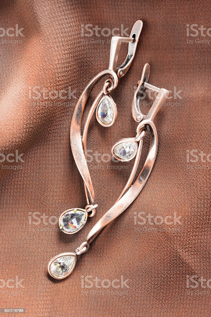 Earrings on cloth stock photo