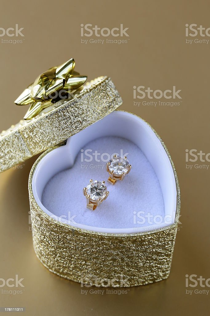 earrings stud with diamonds in a gold box royalty-free stock photo