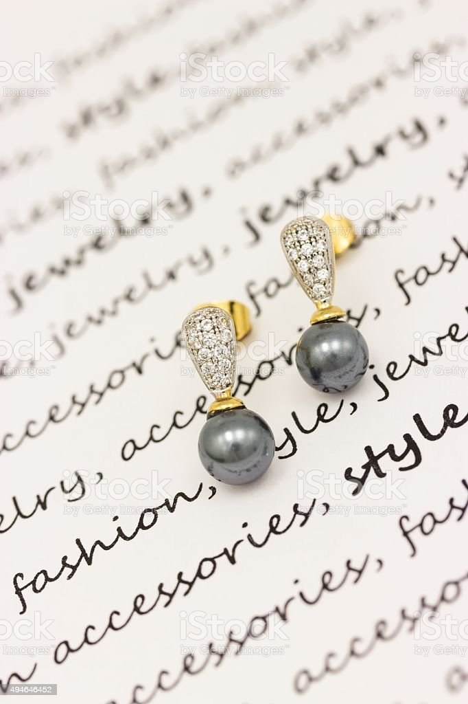 Earrings with black pearls stock photo