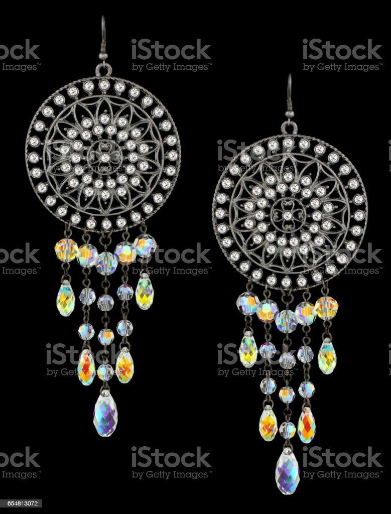 earrings with gems on black stock photo
