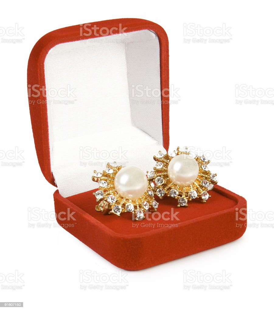 Earrings with pearl and diamonds in red box royalty-free stock photo