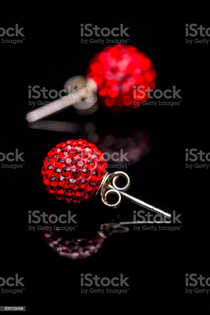 Earrings with red stones stock photo