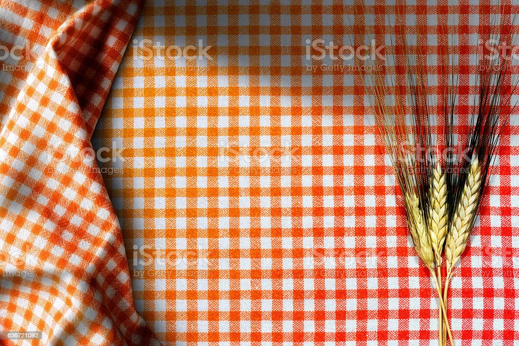 Ears of Wheat on a Checkered Tablecloth stock photo