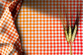 Ears of Wheat on a Checkered Tablecloth