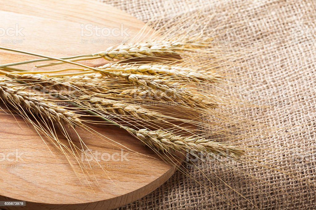 Ears of wheat on a sackcloth stock photo