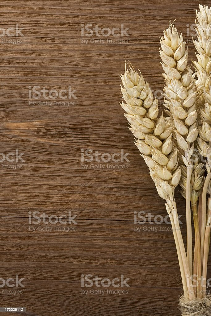 ears of wheat on wood royalty-free stock photo