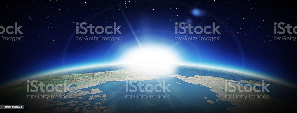 Earth and rising Sun stock photo