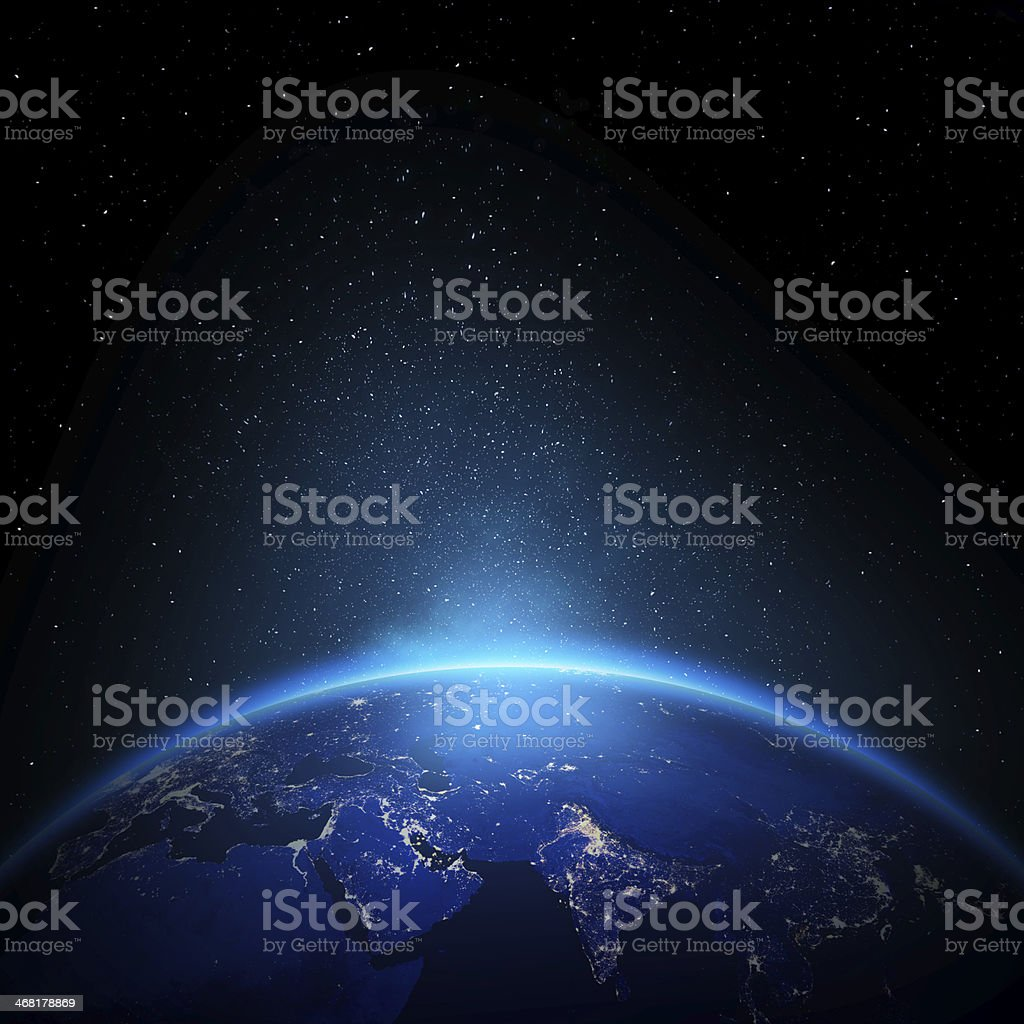 Earth at night with city lights stock photo