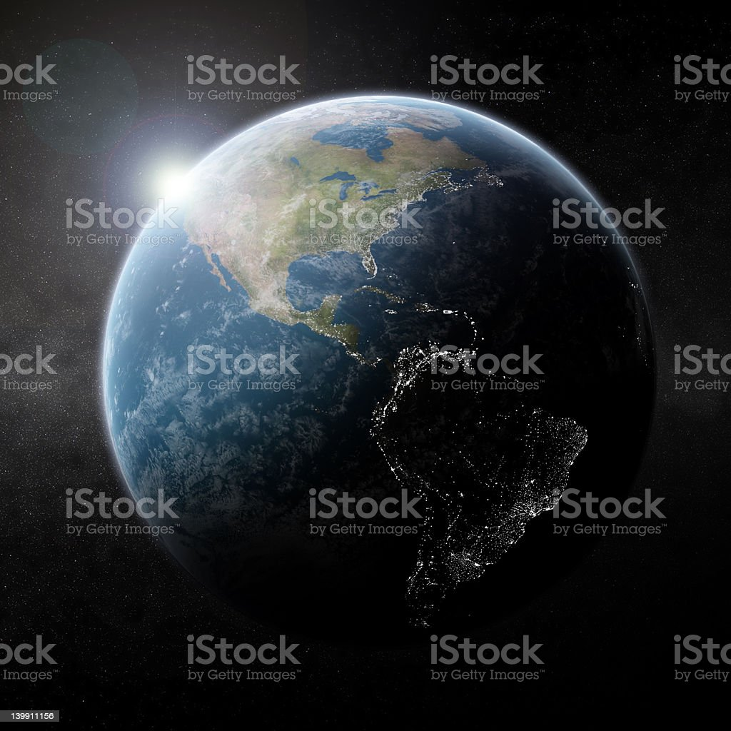Earth by night with sun on the horizon royalty-free stock photo