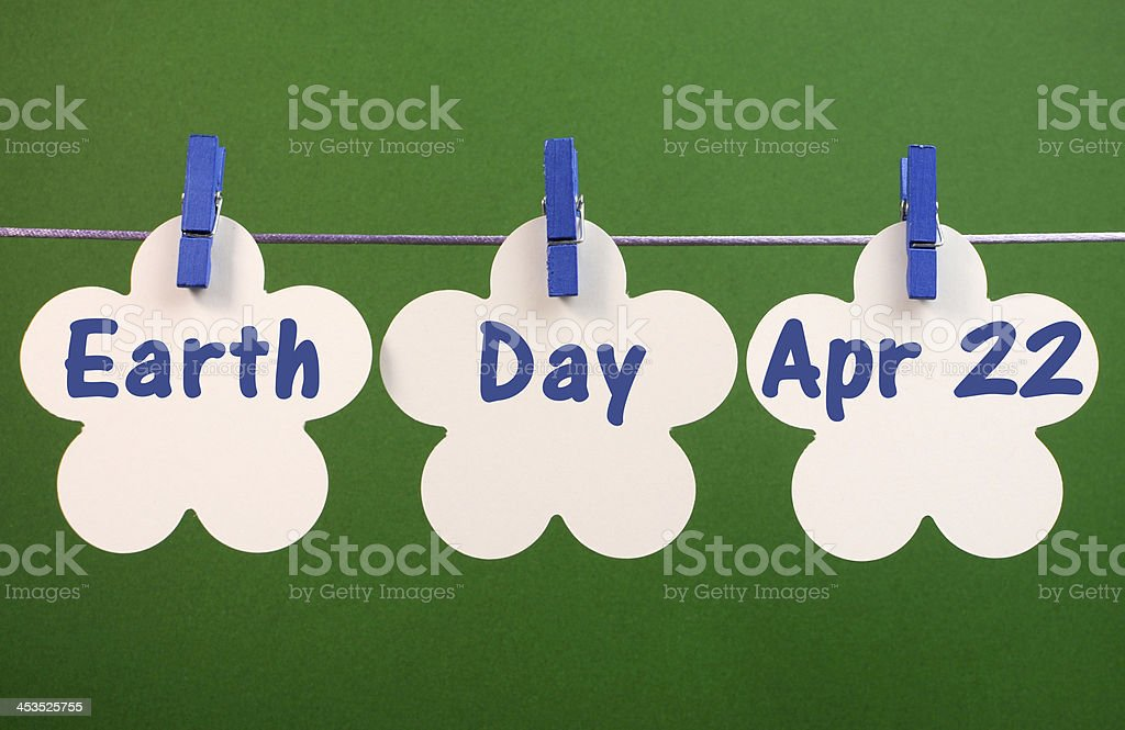 Earth Day message hanging from pegs on a line stock photo