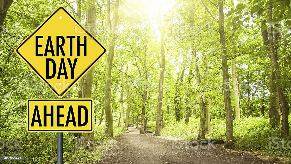 earth day street sign in the forest stock photo