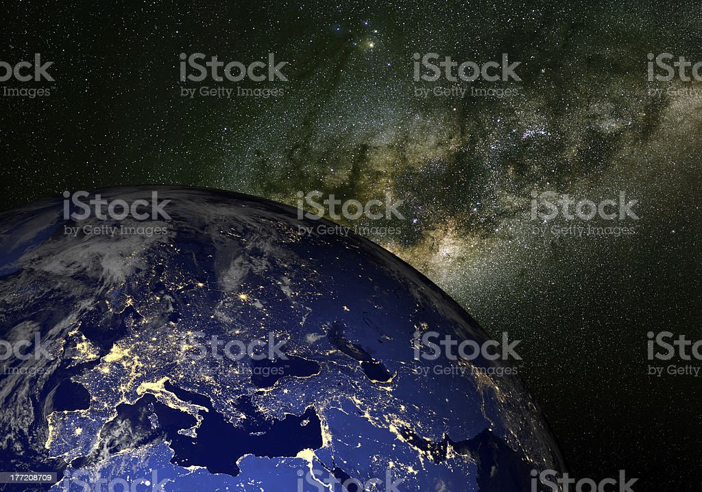 Earth from space at night and the Milky Way. Europe. stock photo