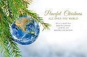 earth globe as christmas bauble, metaphor for universal peace, e