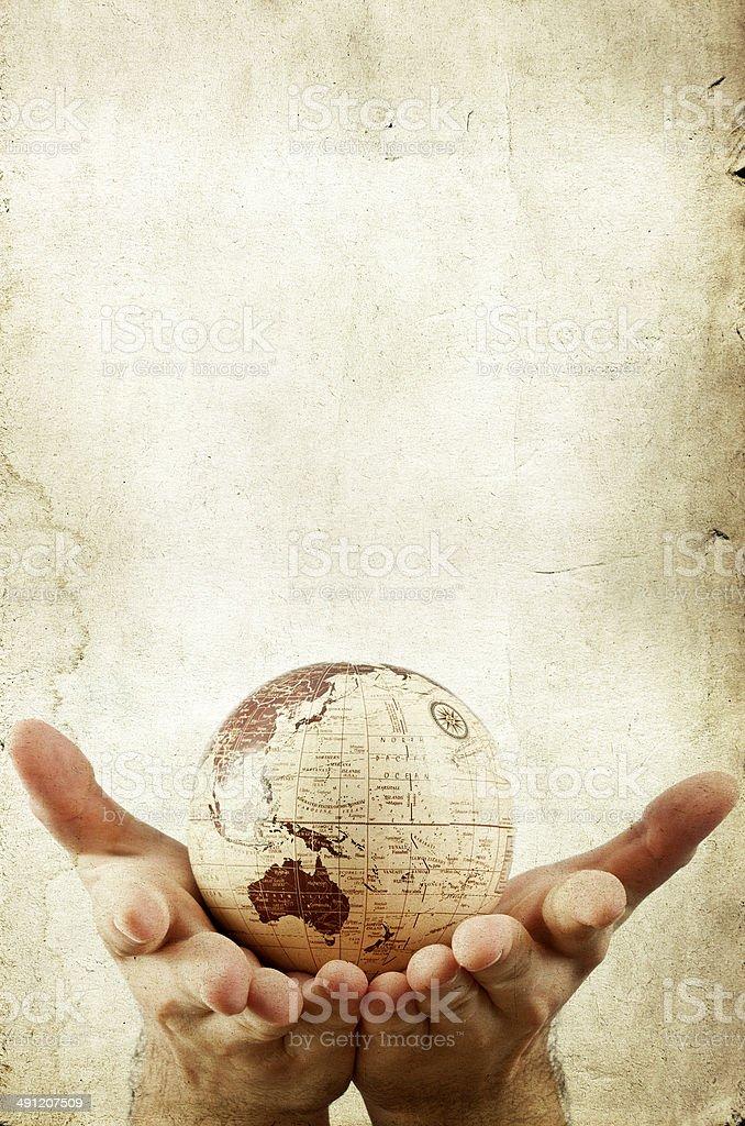 Earth globe in human hands stock photo
