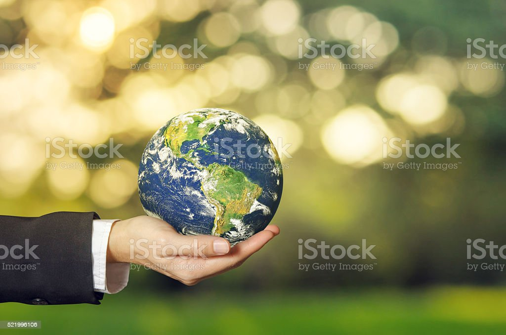 Earth globe in woman's hand stock photo