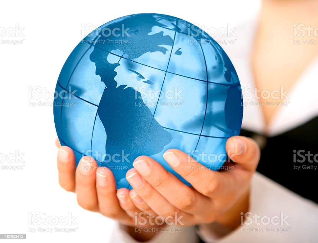 Earth globe (America view) in woman's hands stock photo