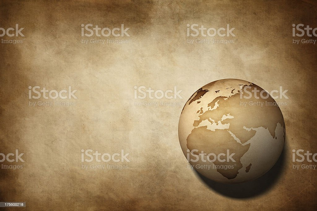 Earth globe on aged paper texture background stock photo